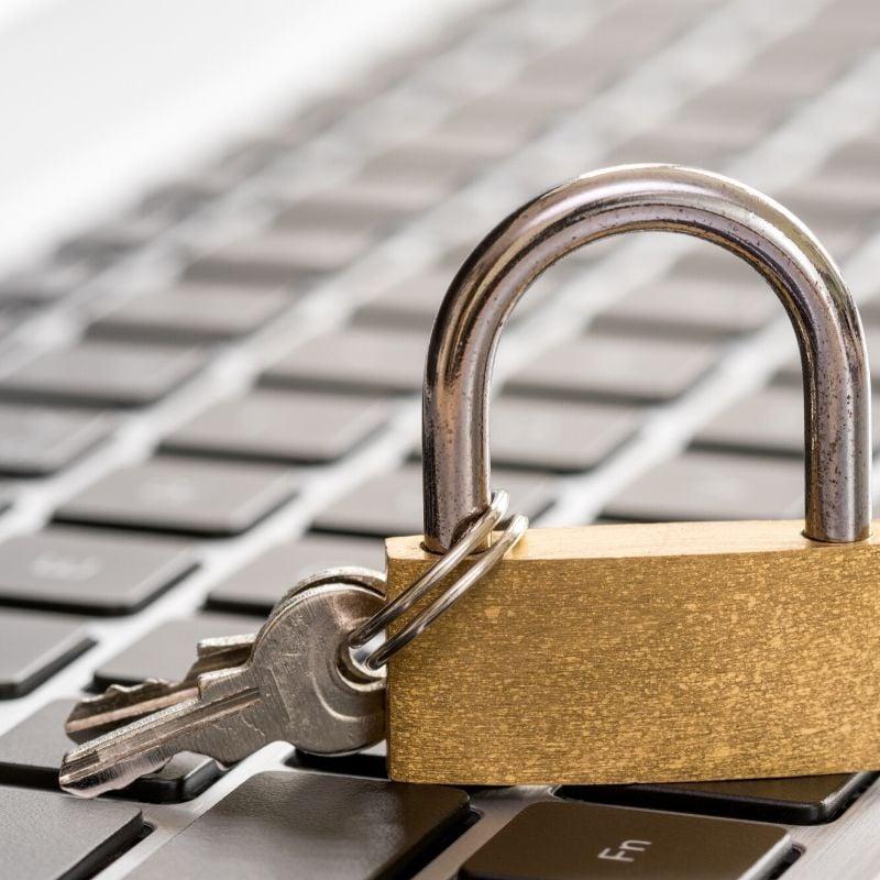 Lock on a keyboard representing cybersecurity