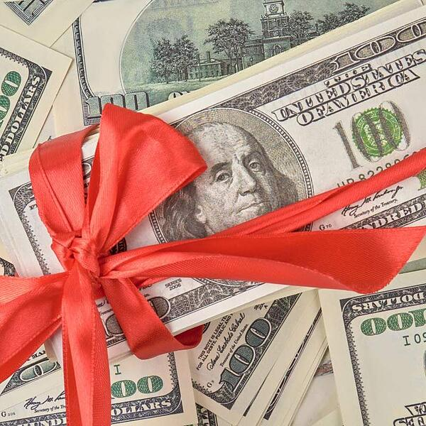 ribbon wrapped money for holiday gift