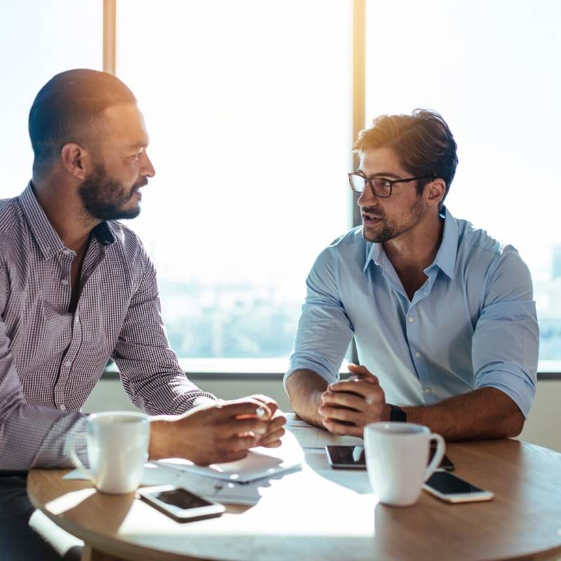 Investment property buyer talking to real estate broker