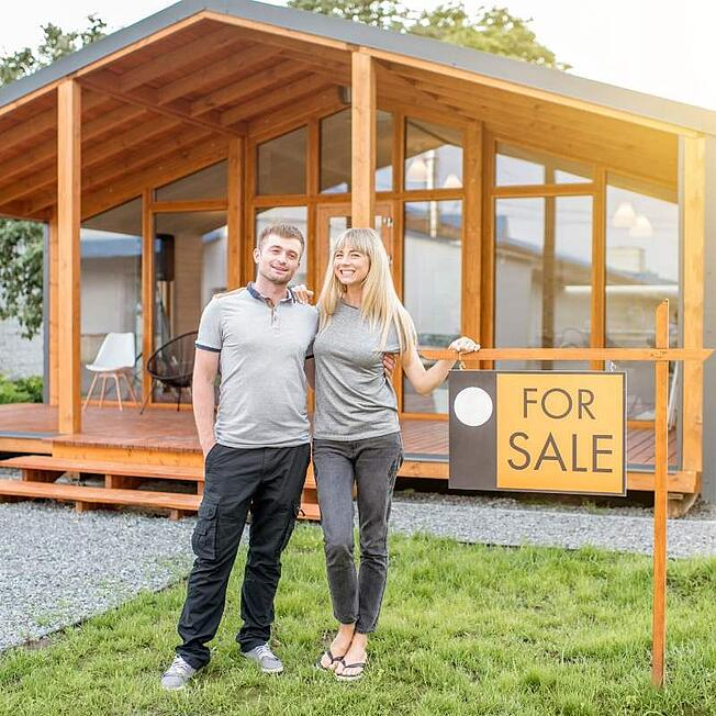 Young couple selling their first investment property