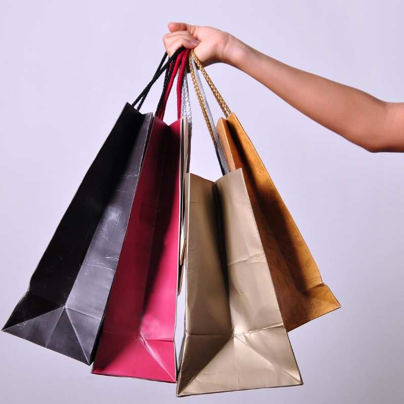 shopping bags containing inexpensive wedding gifts