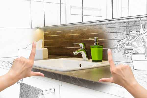 woman's hands framing renovated bathroom sink
