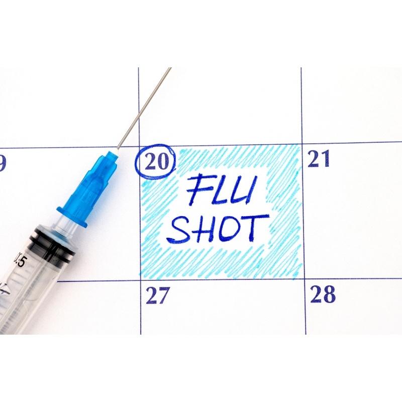 calendar with flu vaccine needle