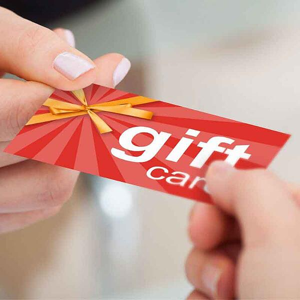 A gift card being given for National Use Your Gift Card Day