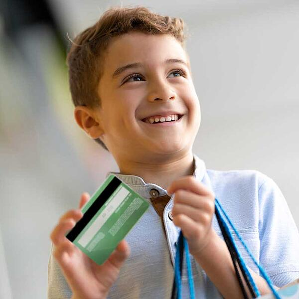 Young boy with authorized user credit card