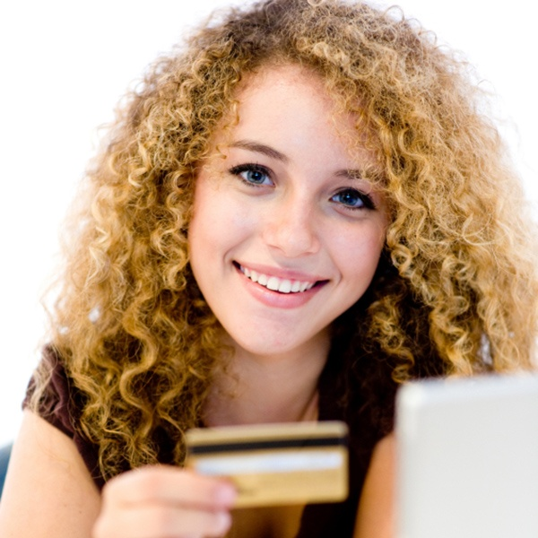 College student holding a credit card.jpg