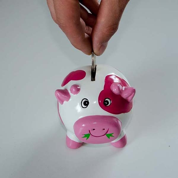 Dropping a coin into a piggy bank