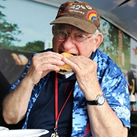 Mike Kaminsky Eating a Burger.jpg