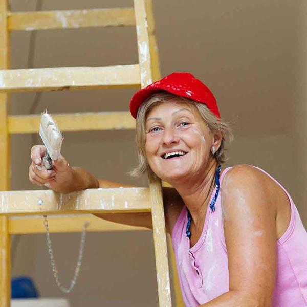 Paint flecked woman on ladder painting.jpg