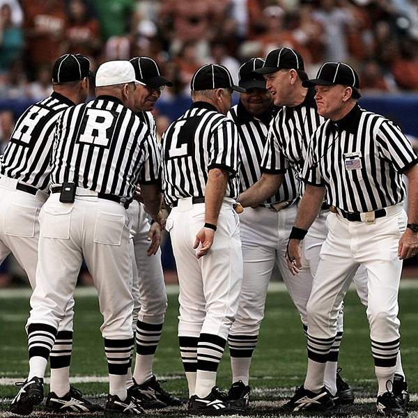 Referees discussing a pre-payment penalty.jpg