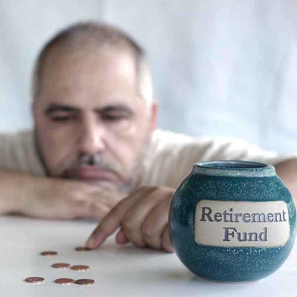Depressed man looking at his retirement savings