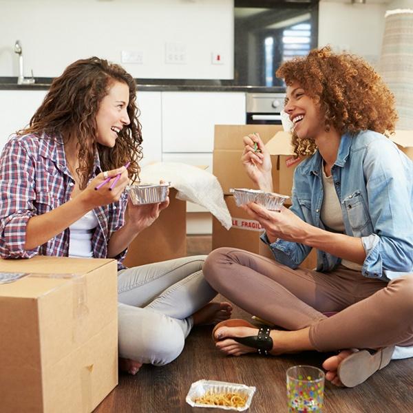 Two women taking a break from moving.jpg
