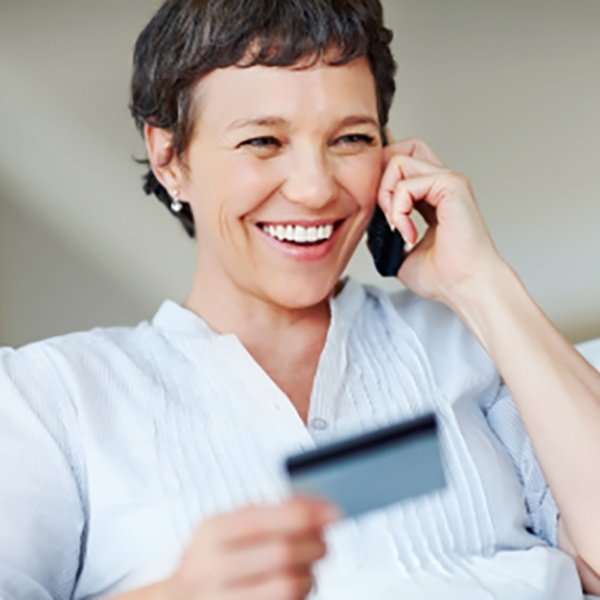 Woman on phone with a credit card.jpg