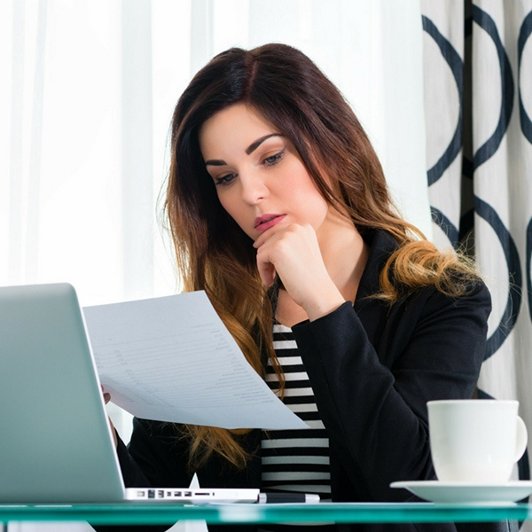 Woman contemplating a legal paper