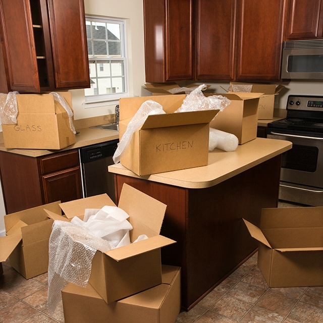 moving boxes in kitchen.jpg