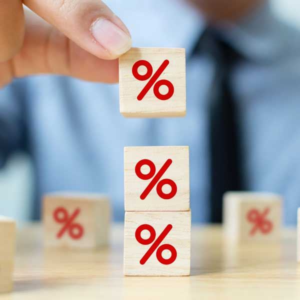 percentage sign on blocks representing higher interest rate credit cards