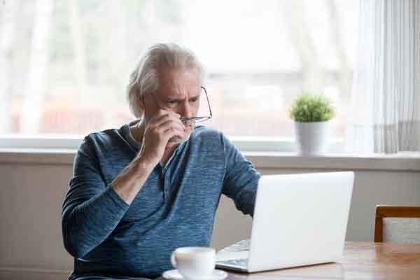 older-man-looking-at-computer-scam-webopt
