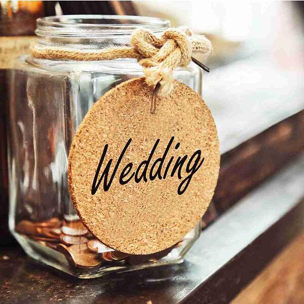 vintage-retro-glass-jar-with-hemp-rope-tie-wedding-tag-and-few-coins-picture-id917550088