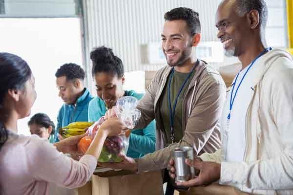 volunteers handing out food at food pantry