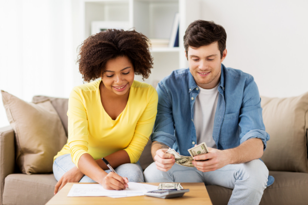 woman and man paying bills in livingroom
