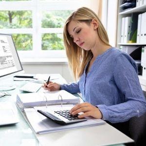 woman using calculator
