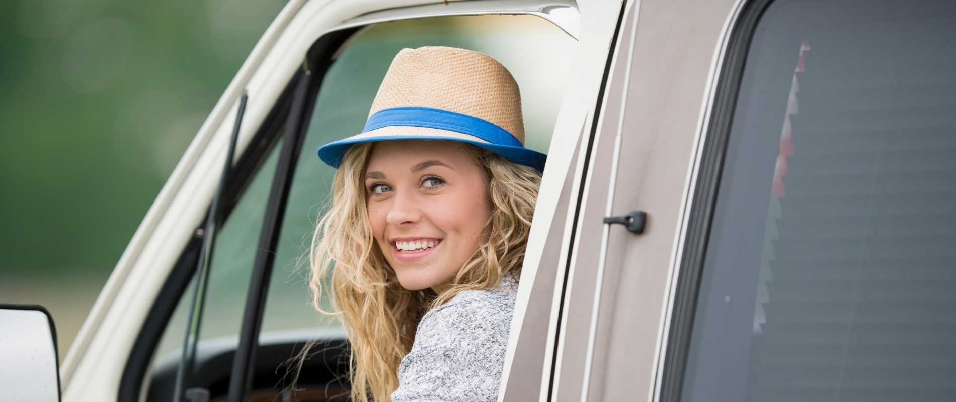 young woman driving truck