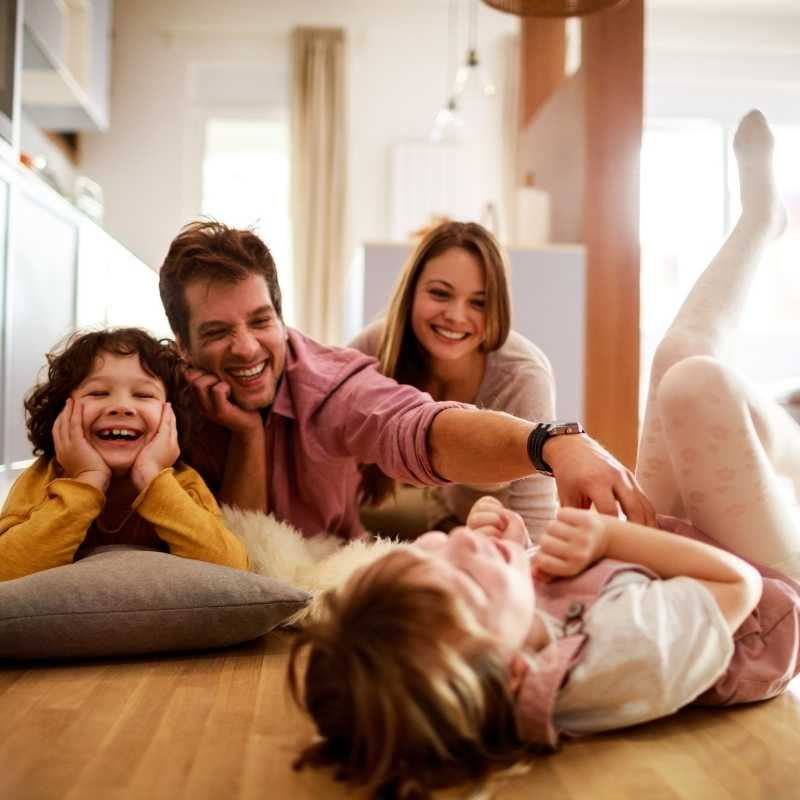 family playing on the floor