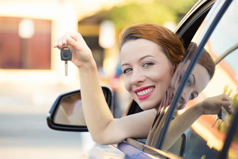 woman in car with keys