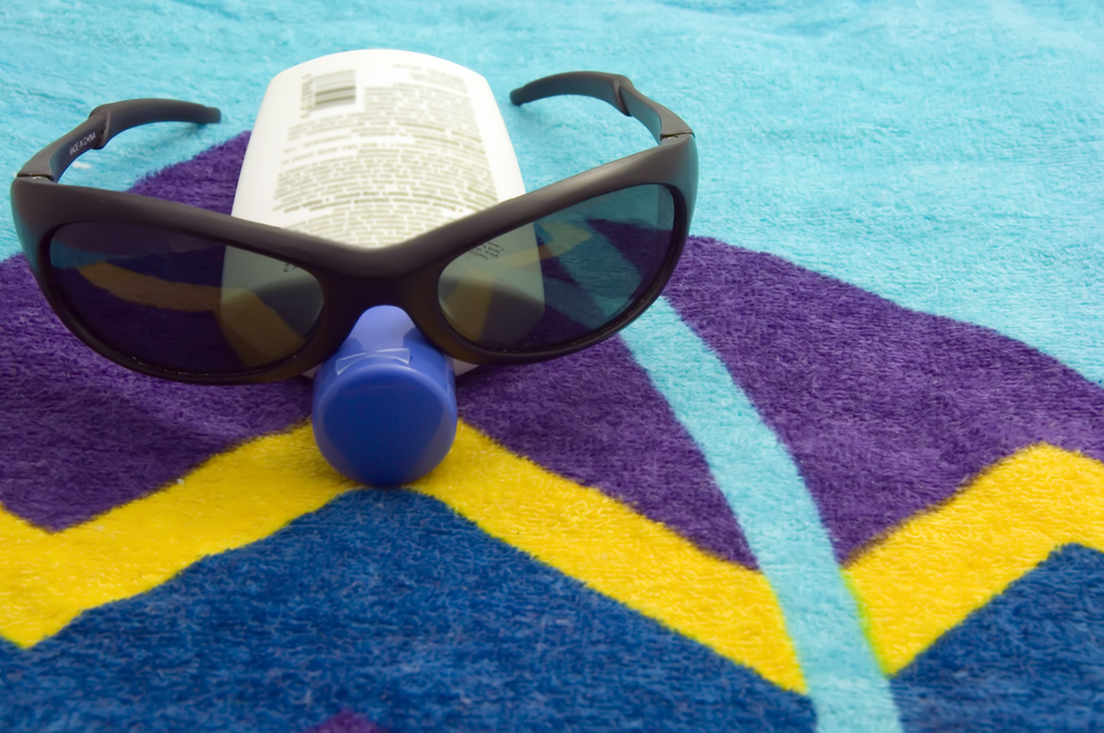glasses on beach towel