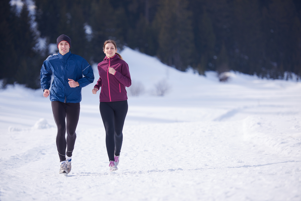 couple running to beat mid-winter blues