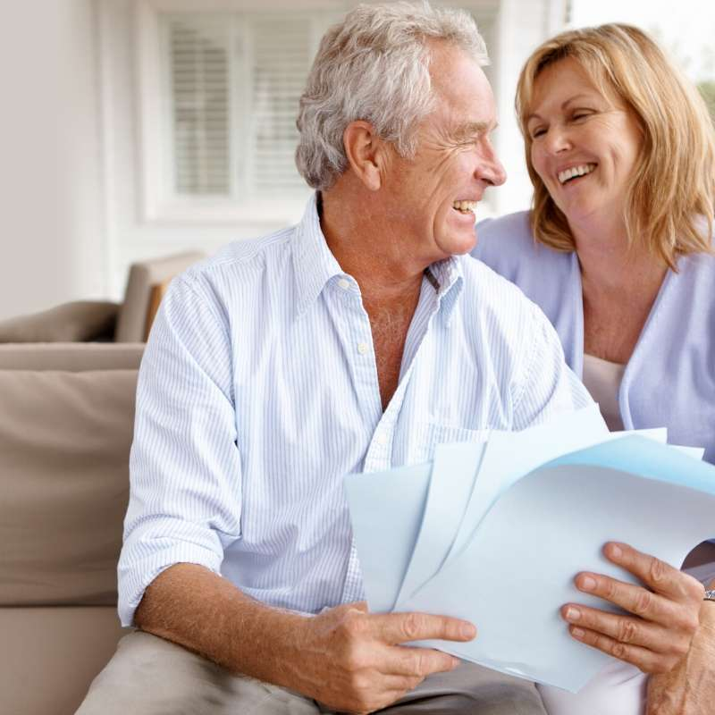 retired couple looking at HECM paperwork