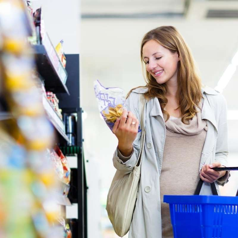young woman saving money shopping for food
