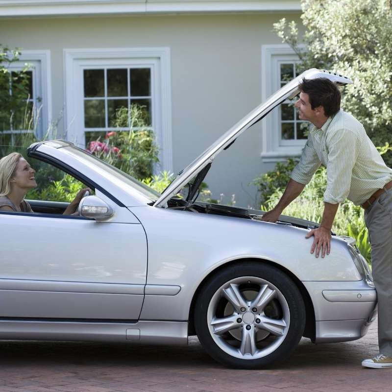 couple with car in driveway