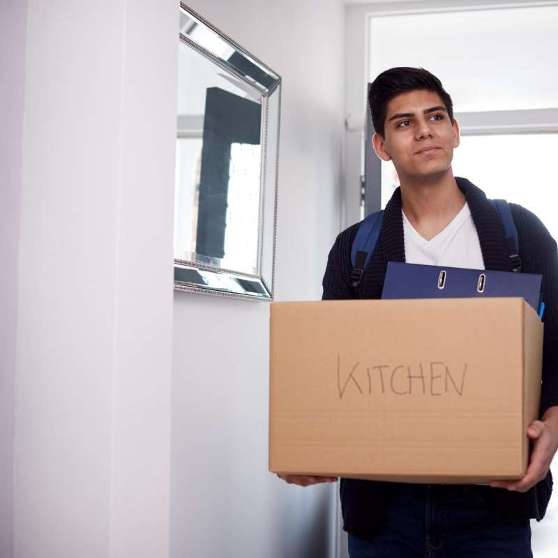 male college student moving in to condo his parents purchased