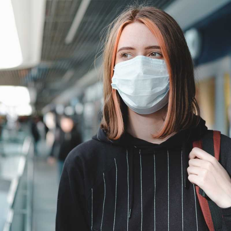 young woman wearing protective mask against coronavirus