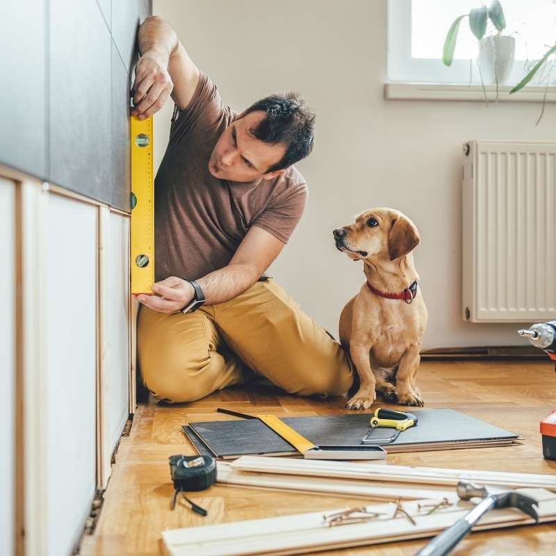 man with dog taking advantage of increased equity in home
