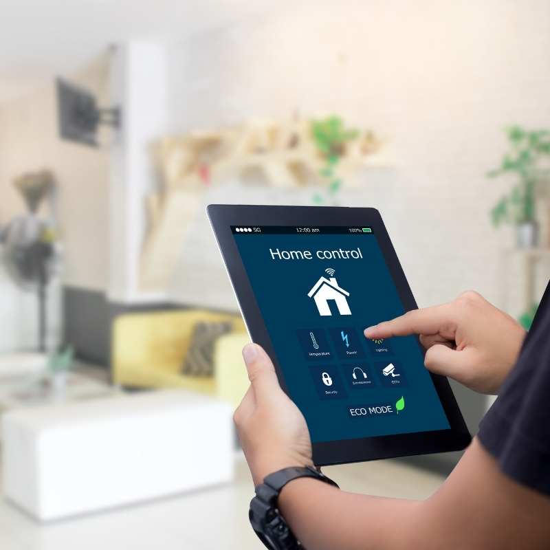 man using home automation app on ipad