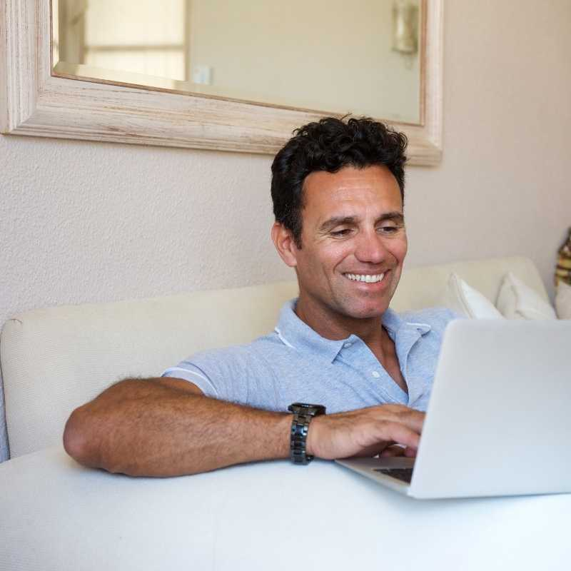middle aged man at laptop not sharing personal identifiable information