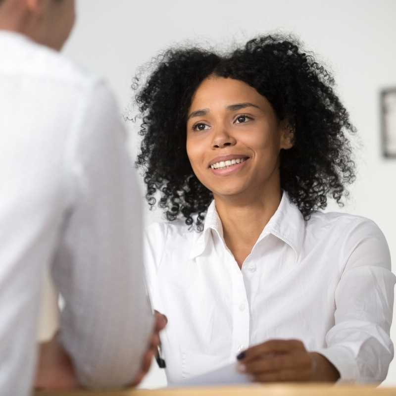 young woman at job interview with credit report