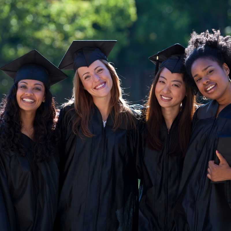 four female college grads together