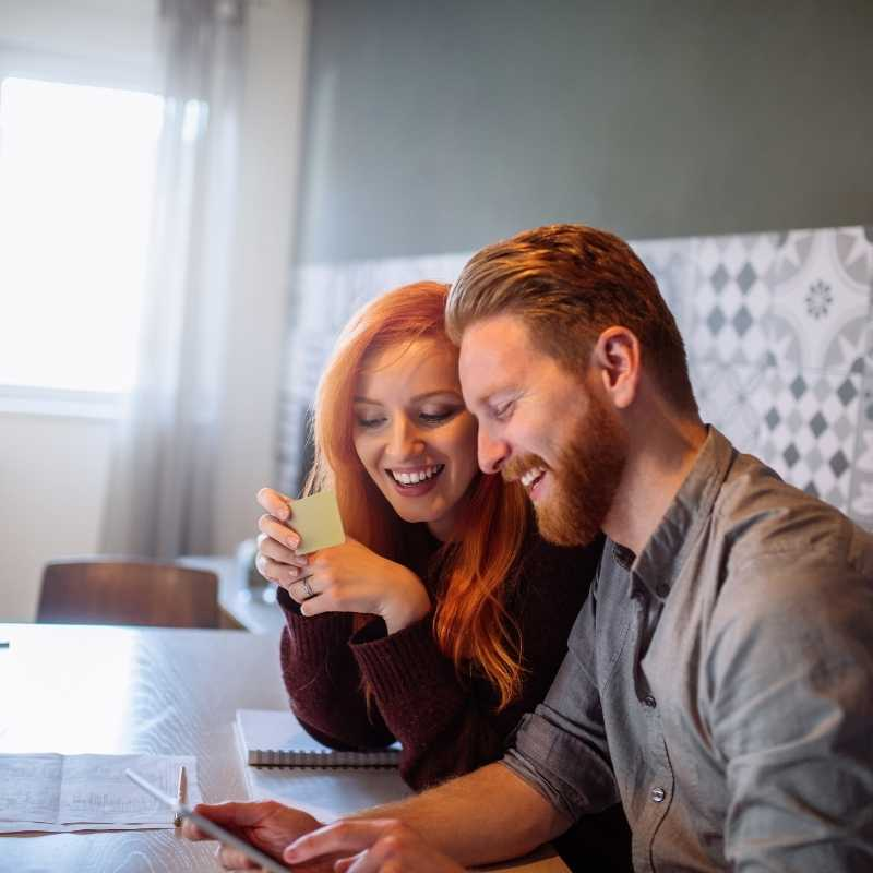 couple at laptop updating credit report manually