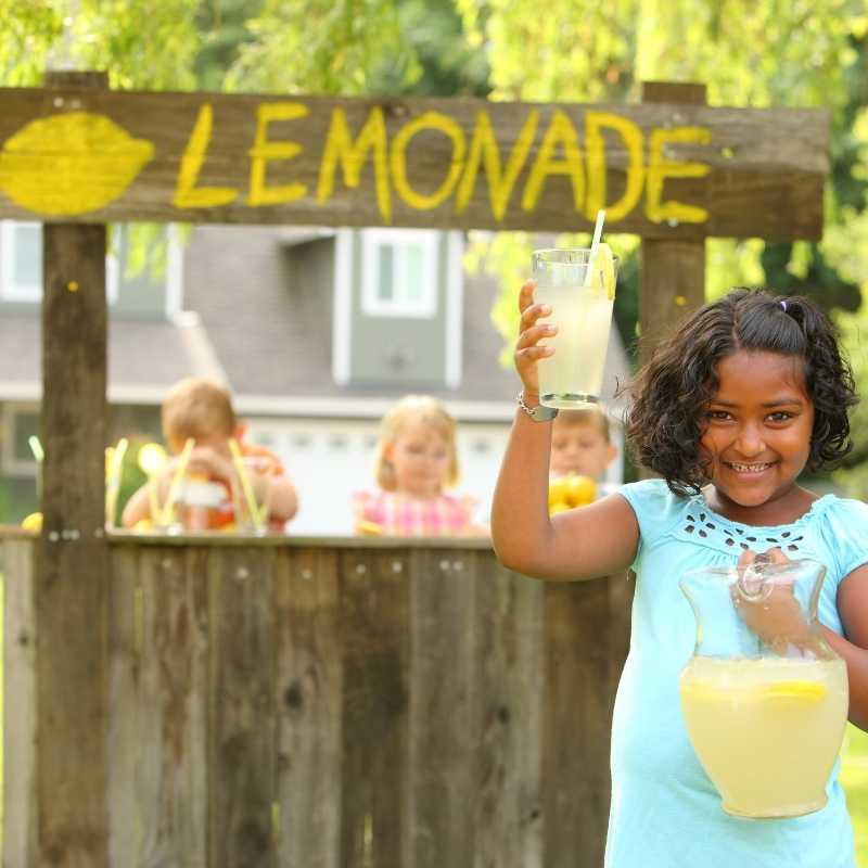 children earning money at lemonade stand