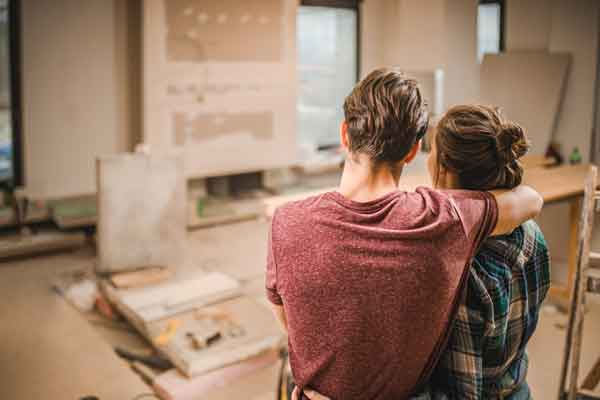 couple-looking-at-home-renovation
