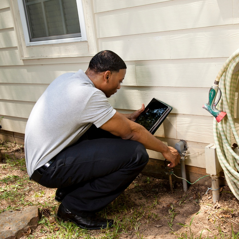 Home Inspector checking an electrical conduit.jpg