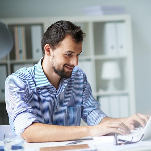 man at laptop using mortgage calculator