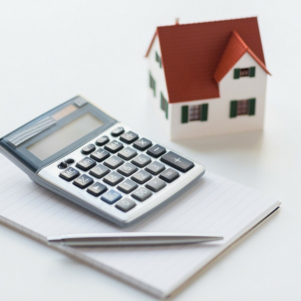 Model Home and Calculator.jpg