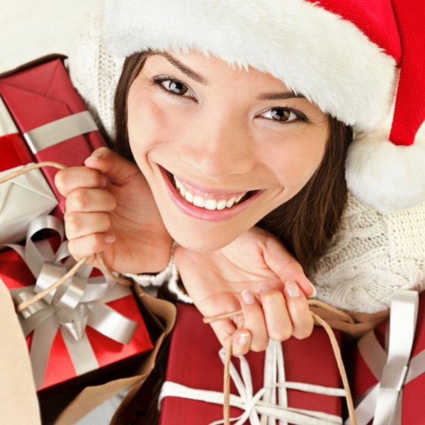 Woman in Santa hat holding gifts.jpg