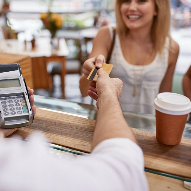 woman buying coffee with a credit card.jpg
