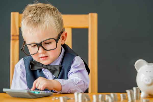 little-boy-in-glasses-with-calculator_webopt