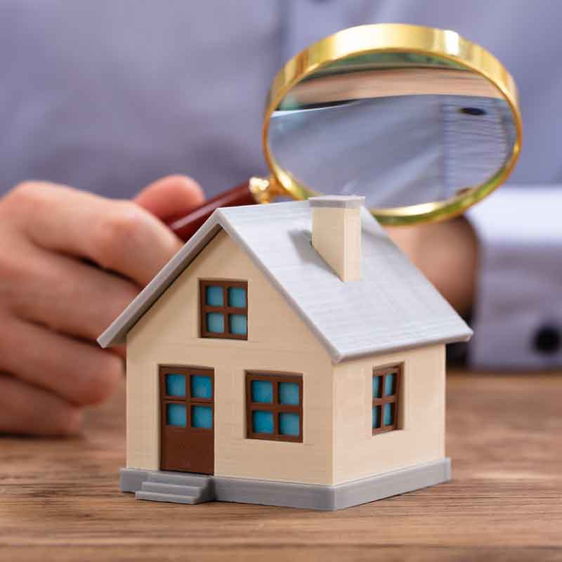model-house-with-magnifying-glass-over-it